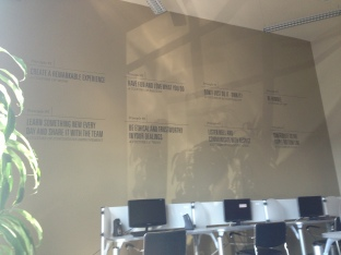 Our 8 Principles displayed on the office wall.